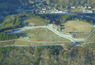 Arial View of the Happy Top Park in Beattyville, KY. Amphitheater, baseball field, softball field, splash park, walking trail, community building.