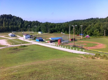 Photo of the Lee County Saddle club house arena and little league softball and baseball fields.